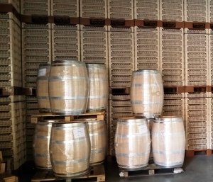 The crates used to dry the Corvina grapes to make Amarone, plus new barrels